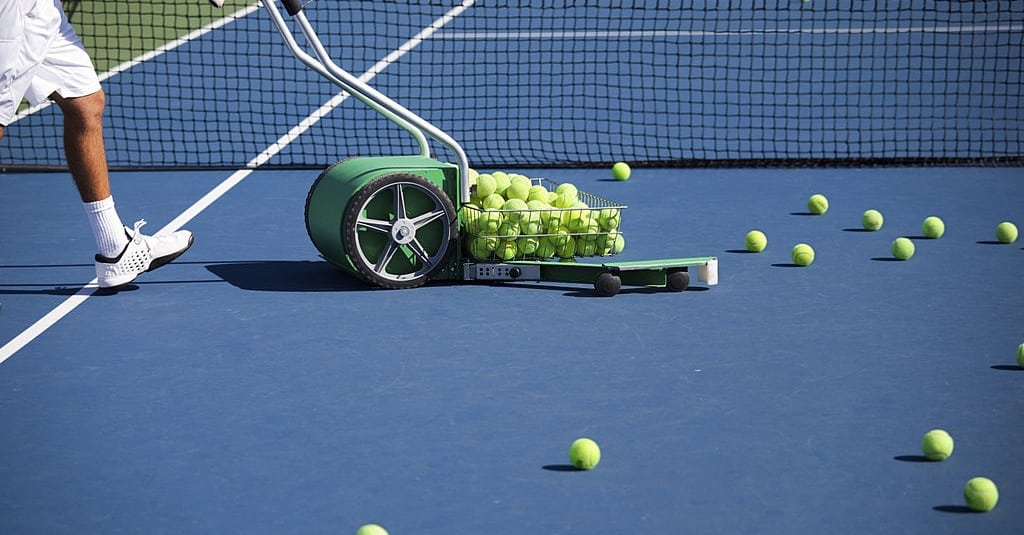 Collecting Balls to store in the Best Tennis Balls Hopper