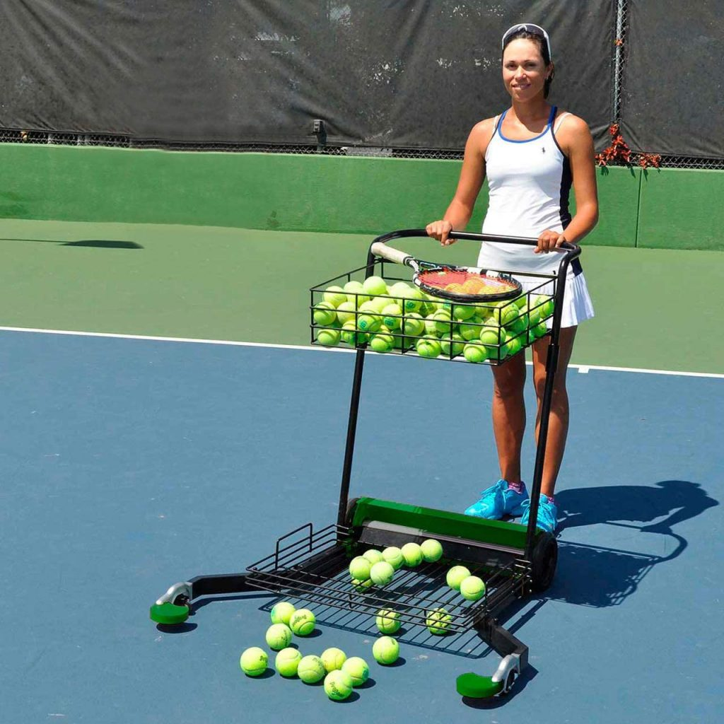 A woman holding the Tennis Multimower as it is the Best Tennis Ball Mower